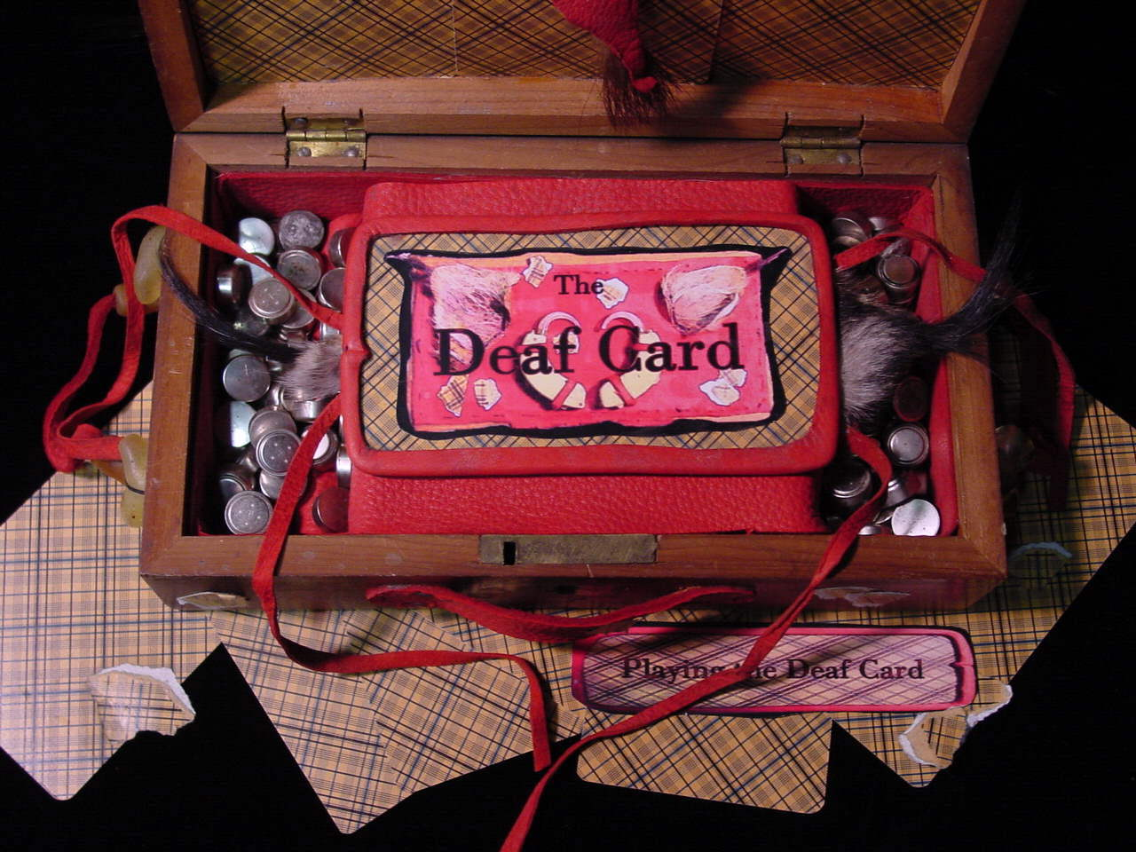 Playing the Deaf Card, detail