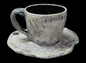 Stretched Steel Cup and Saucer